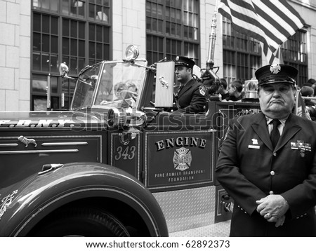 NEW YORK CITY - OCTOBER 11: An official stands in front of his fire truck at the Columbus Day Parade on Fifth Avenue on October 11, 2010 in New York City.