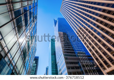 NEW YORK CITY - OCTOBER 10, 2015: skyscrapers in Manhattan with unidentified people. Manhattan is often said to be the economic and cultural center of the United States  #376718512