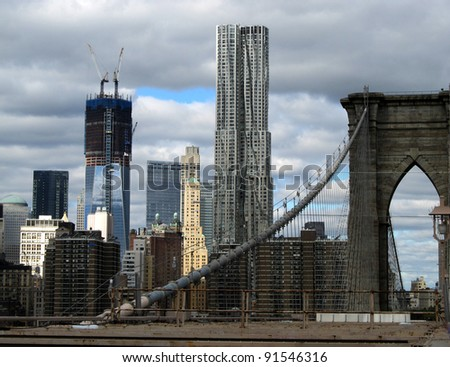 NEW YORK CITY - OCTOBER 21: Standing on the Brooklyn Bridge, one can view the skyline of Manhattan, including the new One WTC and New York by Gehry, shown here on October 21, 2011 in New York City