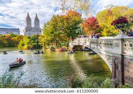NEW YORK CITY - OCTOBER 2015: Tourists in Central Park enjoy foliage season. The city attracts 50 million people annually. - Shutterstock ID 615200000