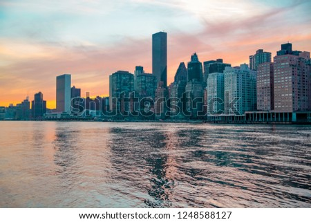 New York City panorama with and skyscrapers and with Manhattan Skyline over Hudson River at sunset light.  #1248588127