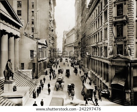 New York City's Wall Street, looking east from the intersection with Broad Street. In foreground left is Federal Hall; on right is J.P. Morgan's bank. Ca. 1910.
