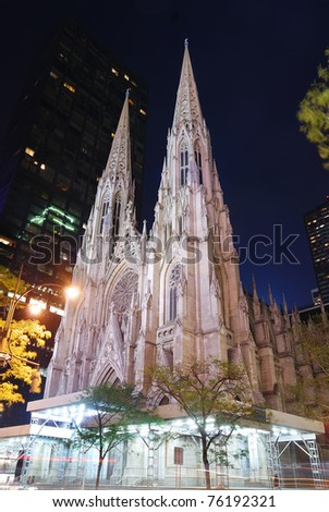 New York City Saint Patrick Cathedral on Manhattan 5th avenue at night lit by lights.