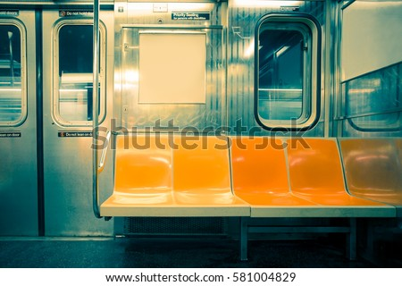 Shutterstock New York City seats on empty subway train car with vintage tone filter