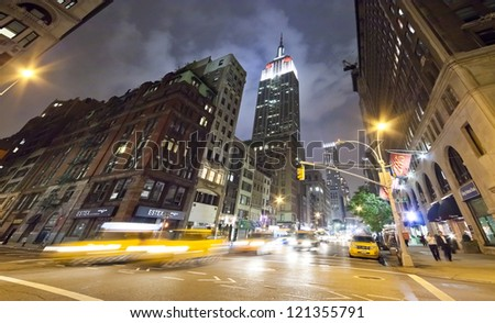 NEW YORK CITY - SEPT 27: Fifth Ave, featured with Taxi Cabs, Shops and significant New York's landmarks, is a symbol of New York City and the United States. September 27, 2012 in Manhattan, New York - stock photo
