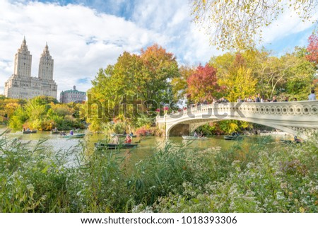 NEW YORK CITY - SEPTEMBER 2015: Tourists enjoy Central Park in autumn. New York attracts 50 million people annually. - Shutterstock ID 1018393306