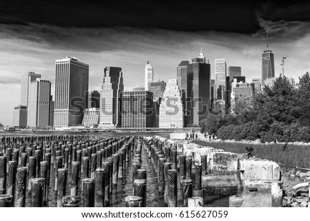 NEW YORK CITY - SEPTEMBER 2015: Tourists visit Brooklyn Bridge Park. The city attracts 50 million people annually. #615627059