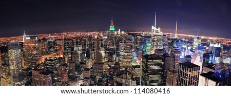 New York City skyline aerial panorama view at night with Empire State Building, Times Square and skyscrapers of midtown Manhattan.