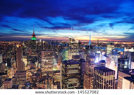 New York City skyline aerial view at dusk with colorful cloud, Empire State and skyscrapers of midtown Manhattan. #145527082