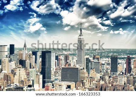 New York City Skyline Aerial View At Sunset With Colorful Cloud And Skyscrapers Of Midtown Manhattan