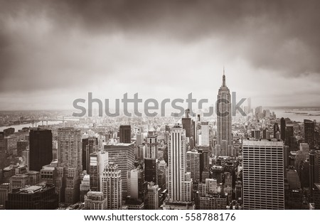 New York City skyline. Aerial view over Manhattan on a cloudy day. Sepia toned image. Old photo stylization.  #558788176