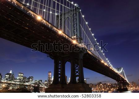 New York City Skyline and Manhattan Bridge At Night #52803358
