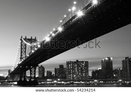 New York City Skyline and Manhattan Bridge At Night #54234214