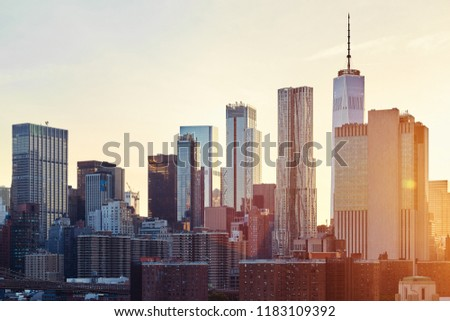 New York City skyline at sunset, color toned picture, USA.