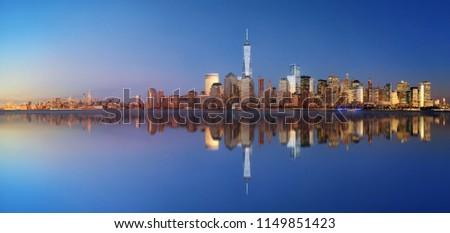 New York City skyline blend with day and night panorama with reflection #1149851423