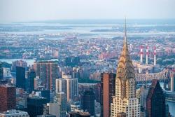 New York City skyline including architectural landmark Chrysler Building in Manhattan, New York, United States of America.