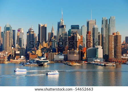 New York City skyline over Hudson river with boat and skyscrapers.