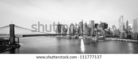 New York City skyline with  Brooklyn Bridge and  Lower Manhattan view in early morning sun light - Black and white - stock photo