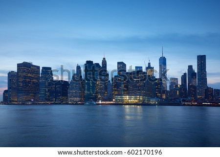 New York city skyline with illuminated buildings in the blue evening hour #602170196