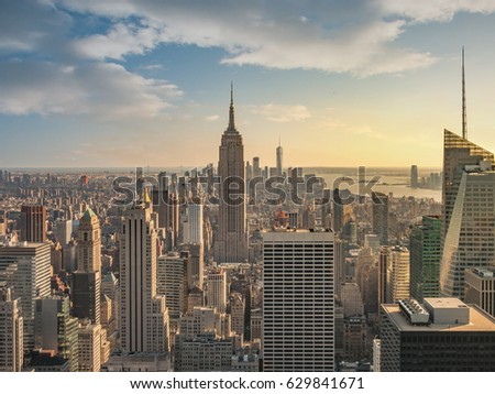 New York City skyline with urban skyscrapers at sunset. #629841671