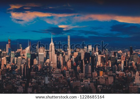 New York city skyline with urban skyscrapers at sunset, NYC USA