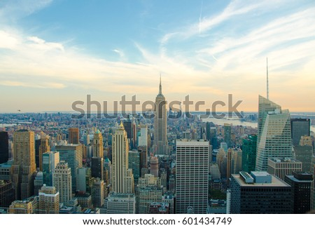 New York City skyline with urban skyscrapers at sunset. The architecture of modern city. Aerial view of Manhattan island with a soft lights and beautiful summer sky. The cultural and financial capital #601434749
