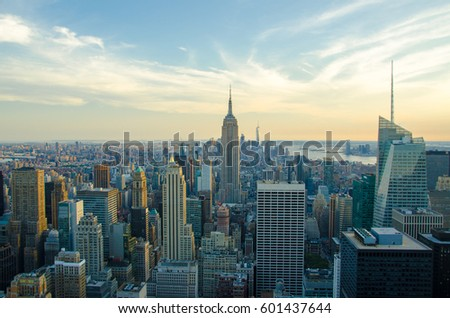 New York City skyline with urban skyscrapers at sunset. The architecture of modern city. Aerial view of Manhattan island with a soft lights and beautiful summer sky. The cultural and financial capital #601437644