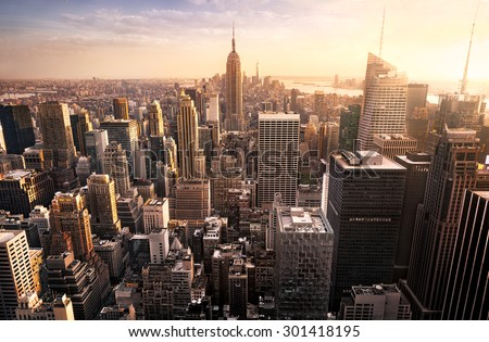 New York City skyline with urban skyscrapers at sunset, USA.