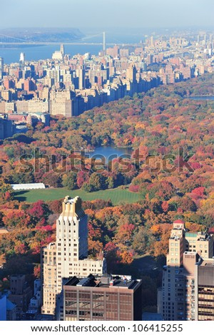 New York City skyscrapers in midtown Manhattan aerial panorama view in the day with Central Park and colorful foliage in Autumn.