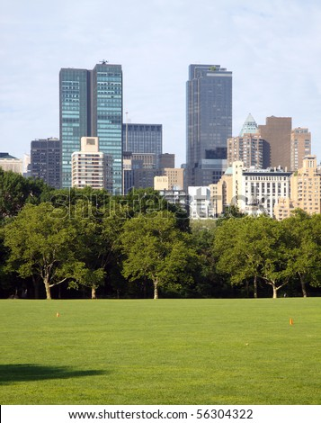 New York City skyscrapers seen across the Sheep's Meadow, Central Park; in vertical orientation