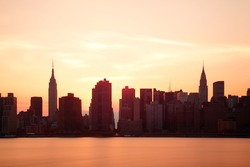 New York City skyscrapers silhouette urban view at sunrise.