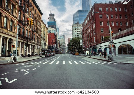 Photo of New York City street road in Manhattan at summer time. Urban big city life concept background.