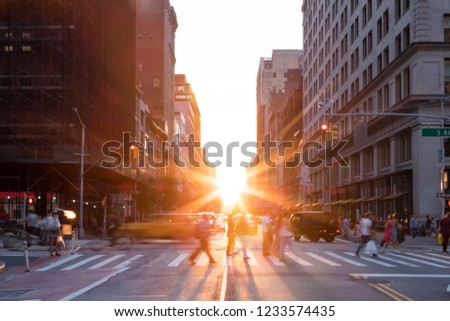 New York City street scene with crowds of people and traffic at the busy intersection of 23rd and 5th Avenue in Manhattan stock photo