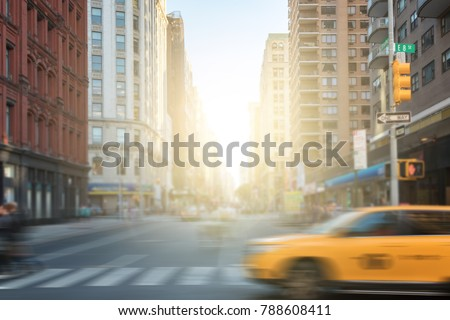 New York City street scene with yellow taxi cab and people crossing Broadway in Manhattan, New York City NYC