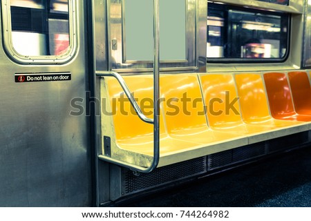 New York City subway interior with colorful seats