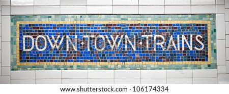 New York city subway sign tile pattern in midtown Manhattan station.