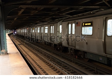 New York City subway train going through the station. F train to Coney Island.  Standing on platform of New York underground train station.  New York public transportation late at night. Stock fotó ©
