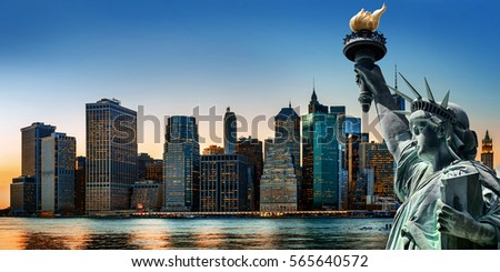 New York City symbols. Skyscrapers of Lower Manhattan and the Statue of Liberty in evening time #565640572