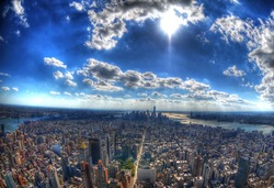 New York City - the skyscrapers and the skyline of Manhattan under the sun in high dynamic range (HDR) through fisheye lens