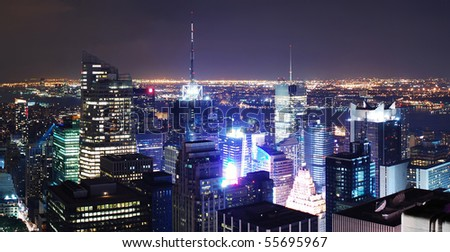 New York City Times Square aerial view panorama at night.