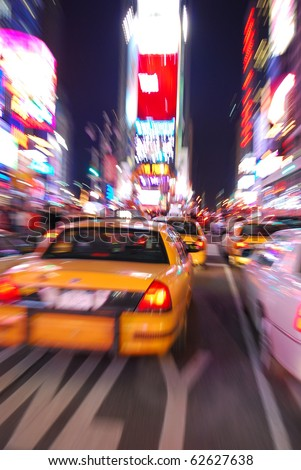 New York City Times Square with Yellow Cab and busy traffic.