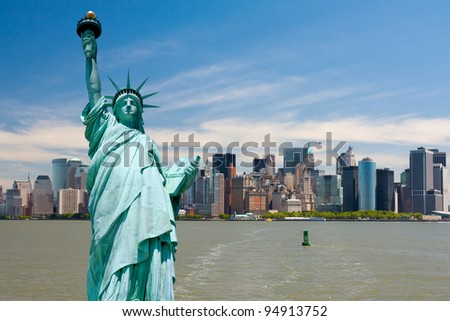 New York city tourism conceptual, Statue of Liberty against Manhattan downtown