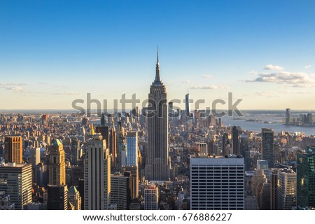 New York City, United States - May 15, 2017: Empire State Building and skyscrapers at sunset. #676886227