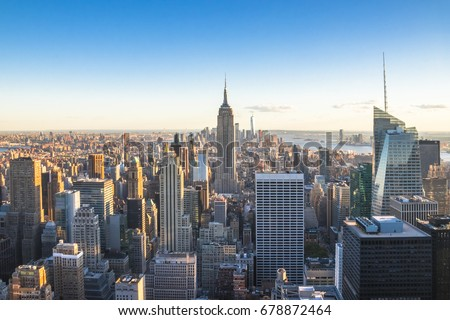 New York City, United States - May 15, 2017: Empire State Building and skyscrapers at sunset. #678872464