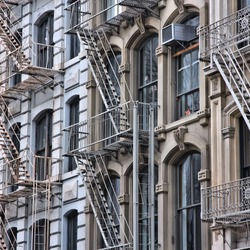 New York City, United States - old residential buildings in Soho district. Fire escape stairs.