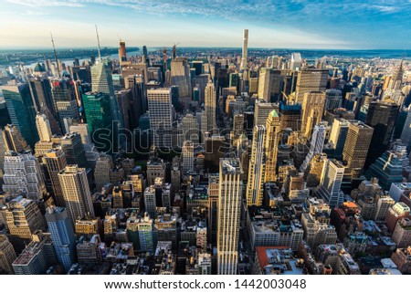 New York City, USA - August 1, 2018: Elevated view of the skyline of modern skyscrapers of Manhattan at sunset in New York City, USA #1442003048