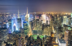 New York City, USA. Night aerial view of Midtown Manhattan skyscrapers from a high viewpoint.