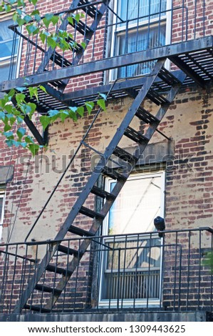 New York City, Usa, United States of America: a building with typical exterior fire escape, which ceased to be required after the 1968 building code