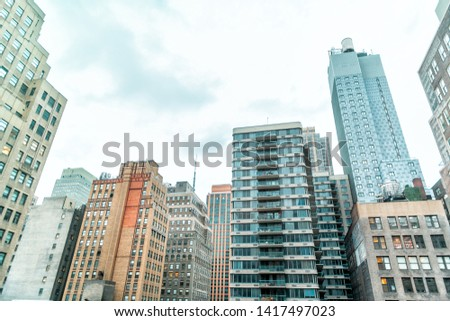 New York City, USA urban cityscape skyline rooftop building skyscrapers in NYC Herald Square Midtown vintage view