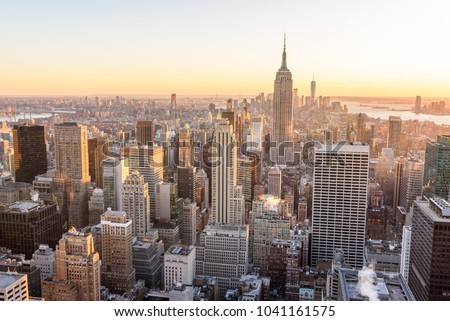 New York City - USA. View to Lower Manhattan downtown skyline with famous Empire State Building and skyscrapers at sunset. #1041161575